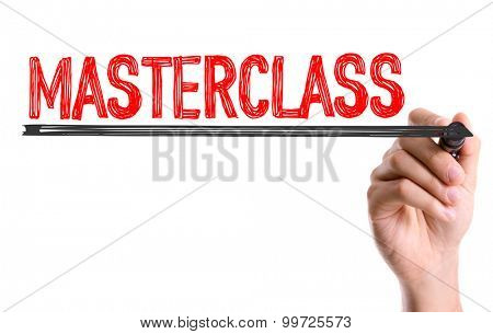 Hand with marker writing the word Masterclass