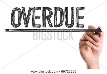 Hand with marker writing the word Overdue