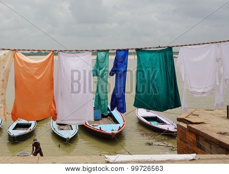 Indian People Washing And Drying Clothing