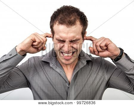 Too much noise or pressure concept - man covering ears for some silence