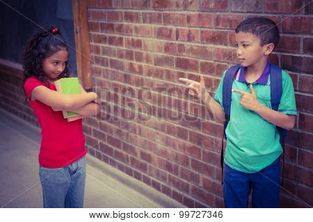 Upset child being teased by another child on the elementary school grounds