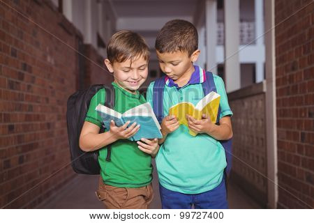 Students reading books together on the elementary school grounds