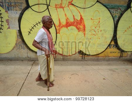 Indian Man Walking In Varanasi