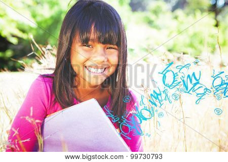 letter and number jumble against cute little girl reading in park