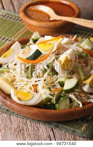 Indonesian Gado-gado Salad Close-up On A Plate. Vertical