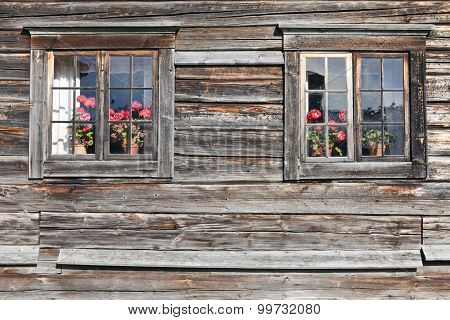 Wooden wall and windows at a ancient building.