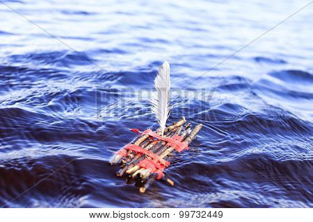 toy raft in middle of sea