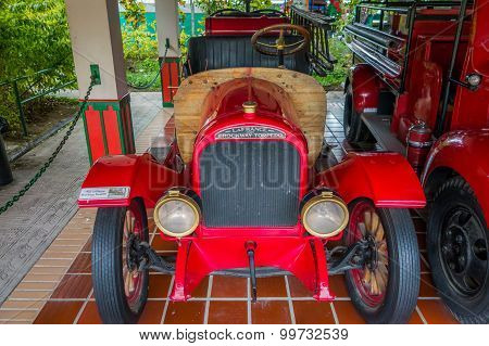 Beautiful antique red firetrucks parked in garage area inside national coffee park at Colombia, shot
