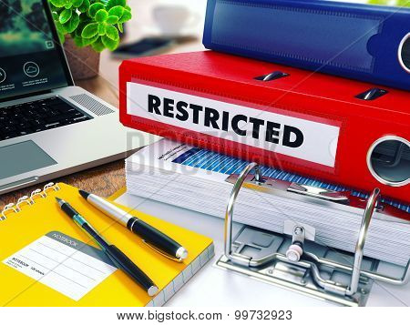 Restricted on Red Ring Binder. Blurred, Toned Image.