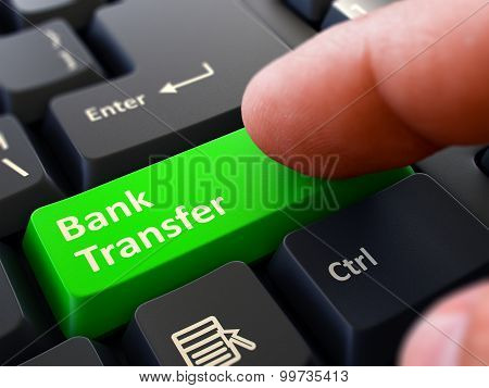 Bank Transfer - Concept on Green Keyboard Button.