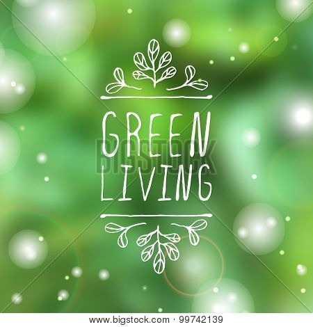 Green living - product label on blurred background.
