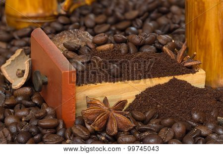 coffee beans and grinded cofee in wood tray with star Anise and cinnamon