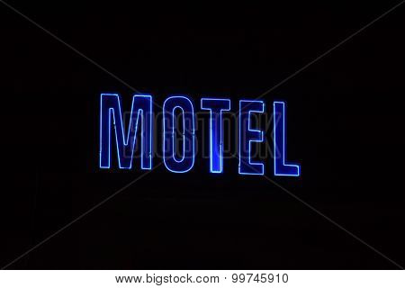 Neon Sign With The Word Motel. Picture Made In The Night.