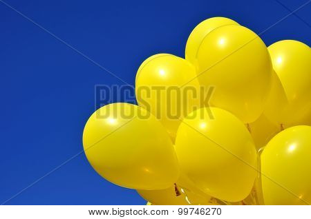 Yellow Balloons On Blue Sky Background