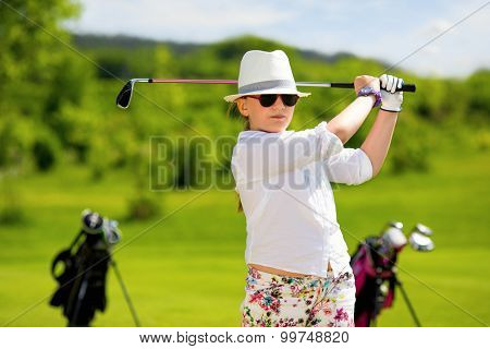 Portrait of boy golfer