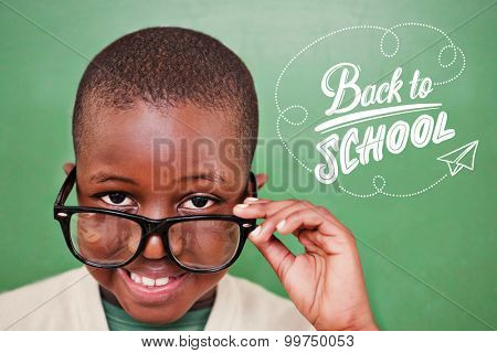 Cute pupil tilting glasses against back to school