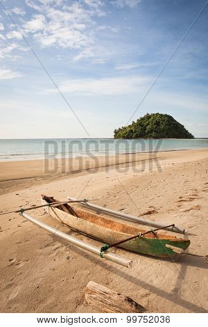 Small fishing boat exotic beach