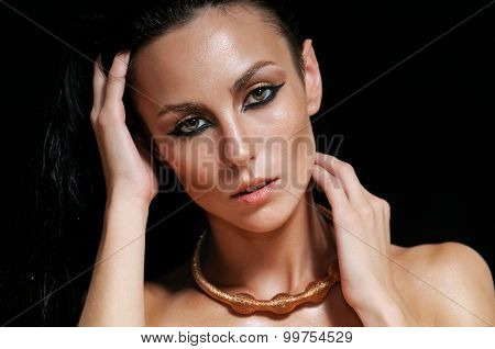 Portrait Of Shining Glamourous Woman With Wet Hair On Black Background