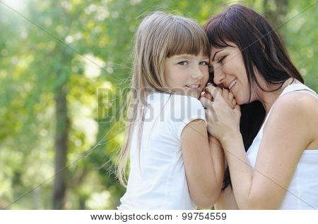 Tender Touch Of Cute Girl And Her Mother