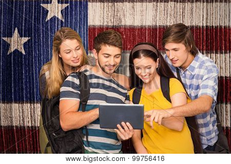 Students using digital tablet at college corridor against composite image of usa national flag