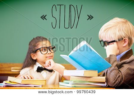 The word study against cute pupils dressed up as teachers in classroom