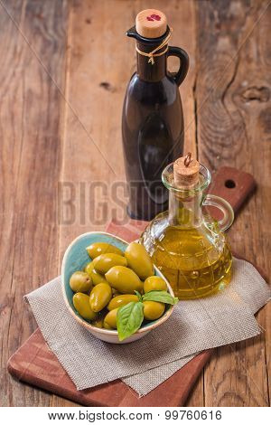 Olive Oil And Olives In Bowl