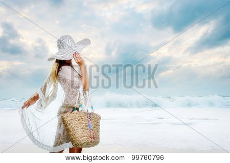 Classy young woman relaxing by the beach