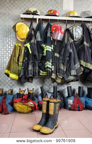 Firefighter uniforms and gear arranged at fire station