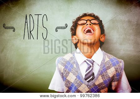 The word arts against boy laughing in front of blackboard