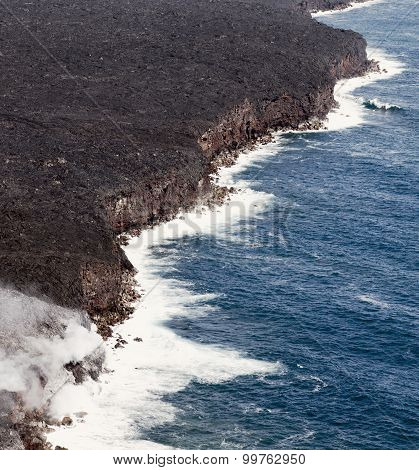 Kilauea lava enters the ocean, expanding coastline.  Kilauea Volcano, Hawaii.