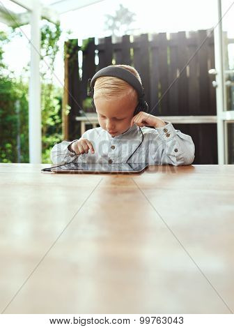 Cute Young Boy Selecting Music To Play