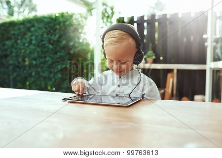Little Boy Listening To His Selected Soundtrack