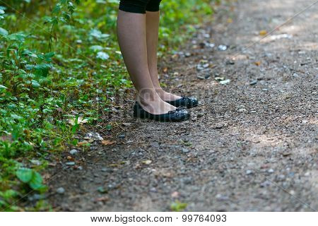 Close Up Of Girl Legs Walking In Forest