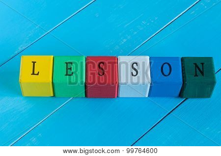 Word Lesson on children's colourful cubes or blocks. Colourful wooden education background