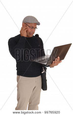 A Hispanic Man Working On His Laptop.