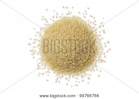 Heap of raw couscous grains on white background