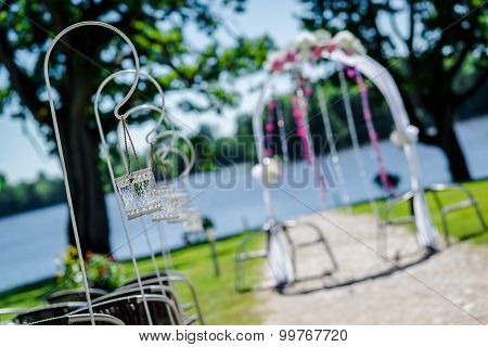 Lakeside Wedding Ceremony. Wedding Arch And Decorations, Selective Focus