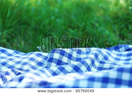 Plaid for picnic on green grass