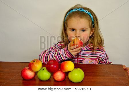 The girl eats an apple