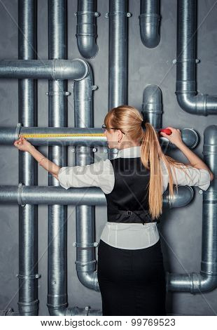 woman measuring pipe length