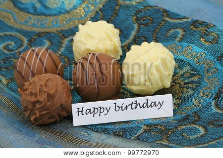 Happy birthday card with assorted truffle and praline chocolates