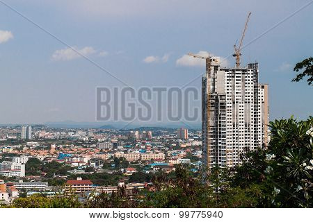 Construction site with crane and building with blue sky