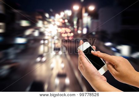 Mobile Smart Phone Behind A Blur Of Traffic