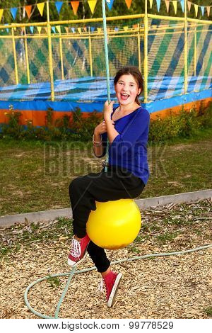 teen girl on cable railway in sport activity amusement park