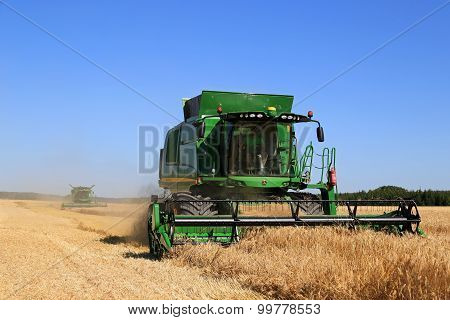 Two John Deere Combines Harvest Barley