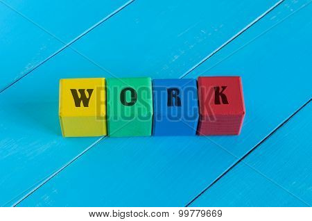 Word Work on children's colourful cubes or blocks. Business background