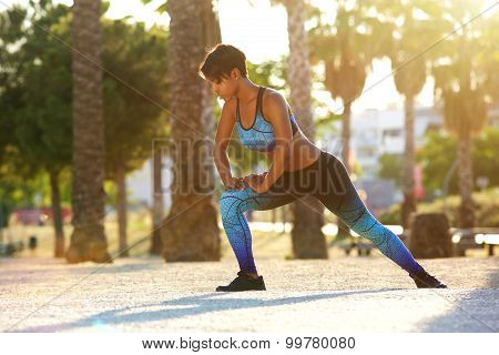 African American Woman Doing Squat Stretching Exercise