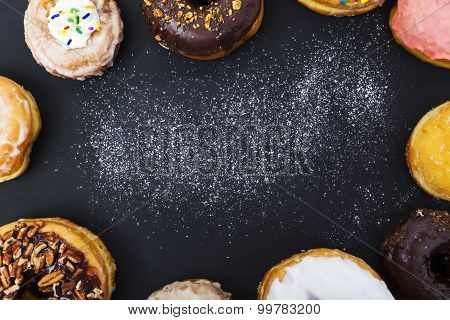 Assorted Donuts On Black Background