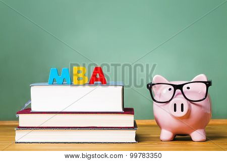 MBA Degree Theme With Textbooks And Piggy Bank