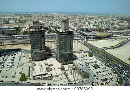 Under construction building in Business Bay Dubai with metro station view